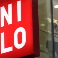 A sign hangs outside Fast Retailing Co.'s Uniqlo store in the Ginza district of Tokyo, Japan, on Thursday, April 8, 2010. Fast Retailing Co., Japan's largest clothing retailer, raised its full-year profit forecast 5.2 percent and said it may list shares overseas, where it expects operating profit to more than quadruple this fiscal year. Photographer: Tomohiro Ohsumi/Bloomberg via Getty Images